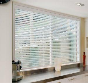 white wooden blind